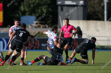 Facundo Cordero of Exeter Chiefs is tackled by Harry Sloan of Saracens