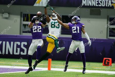 Minnesota Vikings free safety Harrison Smith (22) and cornerback Mike Hughes (21) break up a pass intended for Green Bay Packers wide receiver Marquez Valdes-Scantling (83) during the first half of an NFL football game, in Minneapolis