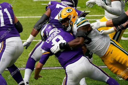 Stock Picture of Green Bay Packers outside linebacker Za'Darius Smith sacks Minnesota Vikings quarterback Kirk Cousins (8) during the first half of an NFL football game, in Minneapolis