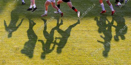 The shadows lengthen at Allianz Park during play