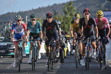 Colombia's Egan Bernal, third left, who lost minutes on his competitors, France's David Gaudu, left, France's Pierre Rolland, second left, Belgium's Wout Van Aert, third from right, Poland's Michal Kwiatkowski, second right, and Colombia's Daniel Felipe Martinez, ride towards the finish line of stage 15 of the Tour de France cycling race over 174.5 kilometers (108.4 miles) from Lyon to Grand Colombier pass, France