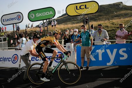With few spectators seen on the finish line, a man pushes Netherland's Tom Dumoulin after he crossed the finish line of stage 15 of the Tour de France cycling race over 174.5 kilometers (108.4 miles) from Lyon to Grand Colombier pass, France
