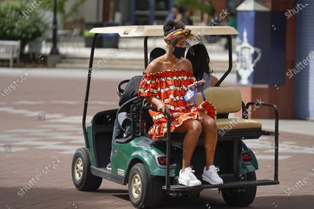 Stock Photo of Naomi Osaka, of Japan, is driven away after posing for photographs at the Billie Jean King National Tennis Center, in New York