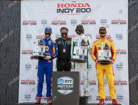 Team owner Michael Andretti, center, black shirt, stands with his team drivers, race winner Colton Hereta, center right, second place finisher Alexander Rossi, left, and third place finisher Ryan Hunter-Reay, right. The Andretti sponsored team drivers swept the top three spots at the IndyCar Series auto race, at Mid-Ohio Sports Car Course, in Lexington, Ohio