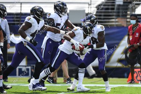 Baltimore Ravens safety Anthony Levine Sr. (41) celebrates fumble recovery with teammates in the first half during an NFL football game against the Cleveland Browns, in Baltimore