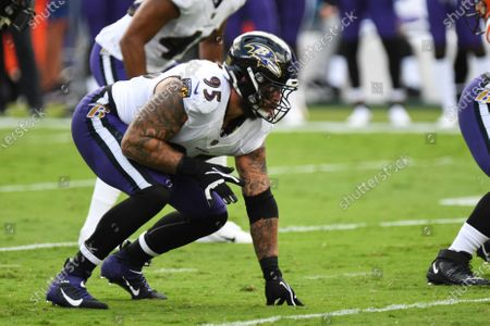 Baltimore Ravens defensive end Derek Wolfe (95) lines up prior to snap in the first half during an NFL football game against the Cleveland Browns, in Baltimore