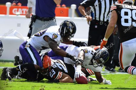 Baltimore Ravens safety Anthony Levine Sr. (41) recovers Cleveland Browns safety Andrew Sendejo (23) fumble in the first half during an NFL football game, in Baltimore