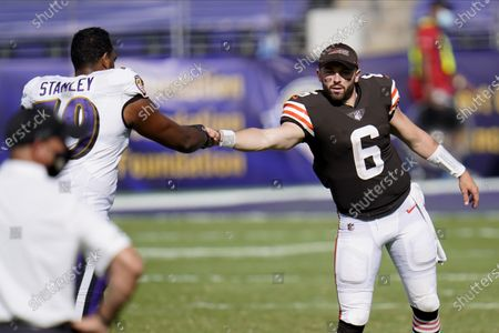 Baltimore Ravens offensive tackle Ronnie Stanley (79) talks with Cleveland Browns quarterback Baker Mayfield (6) after an NFL football game, in Baltimore. The Ravens won 38-6