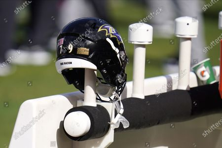 """End racism"""" is seen on the helmet of Baltimore Ravens offensive tackle Ronnie Stanley as it rests on the bench during the second half of an NFL football game against the Cleveland Browns, in Baltimore. The Ravens won 38-6"""