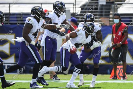 Baltimore Ravens safety Anthony Levine Sr. (41) celebrates fumble recovery in the first half during an NFL football game against the Cleveland Browns, in Baltimore