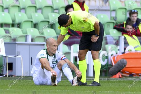 Stock Photo of Arjen Robben of Groningen reacts after suffering an injury during the Dutch Eredivisie soccer match between FC Groningen and PSV at the Hitachi Capital Mobility stadium in Groningen, The Netherlands, 13 September 2020.