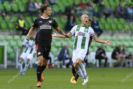 Stock Picture of Arjen Robben (R) of FC Groningen and Olivier Boscagli or PSV in action during the Dutch Eredivisie soccer match between FC Groningen and PSV at the Hitachi Capital Mobility stadium in Groningen, The Netherlands, 13 September 2020.