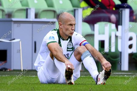 Stock Image of Arjen Robben of Groningen reacts after suffering an injury during the Dutch Eredivisie soccer match between FC Groningen and PSV at the Hitachi Capital Mobility stadium in Groningen, The Netherlands, 13 September 2020.
