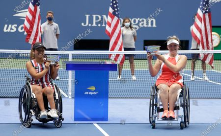 Yui Kamiji of Japan (L) and her teammate Jordanne Whiley of Great Britain (R) hold their championship trophies after defeating Marjolein Buis of the Netherlands and her teammate Diede De Groot of the Netherlands during the Women's Doubles Wheel Chair Final match on the fourteenth day of the US Open Tennis Championships the USTA National Tennis Center in Flushing Meadows, New York, USA, 13 September 2020. Due to the coronavirus pandemic, the US Open is being played without fans and runs from 31 August through 13 September.