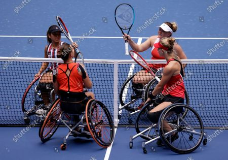 Yui Kamiji of Japan (Top-L) and her teammate Jordanne Whiley of Great Britain (Top-R) celebrate defeating Marjolein Buis of the Netherlands (Bottom-L) and her teammate Diede De Groot of the Netherlands (Bottom-R) at the conclusion of the Women's Doubles Wheel Chair Final match on the fourteenth day of the US Open Tennis Championships the USTA National Tennis Center in Flushing Meadows, New York, USA, 13 September 2020. Due to the coronavirus pandemic, the US Open is being played without fans and runs from 31 August through 13 September.