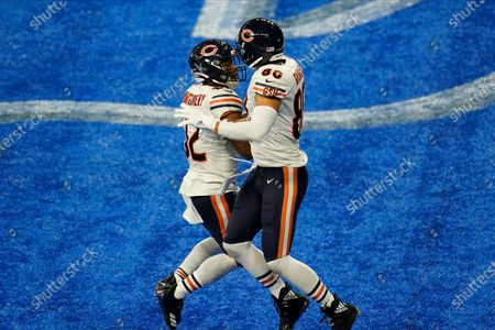 Stock Photo of Chicago Bears tight end Jimmy Graham (80) celebrates his touchdown reception with David Montgomery (32) in the second half of an NFL football game against the Detroit Lions in Detroit