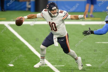 Chicago Bears quarterback Mitchell Trubisky rolls out to throw against the Detroit Lions in the first half of an NFL football game in Detroit