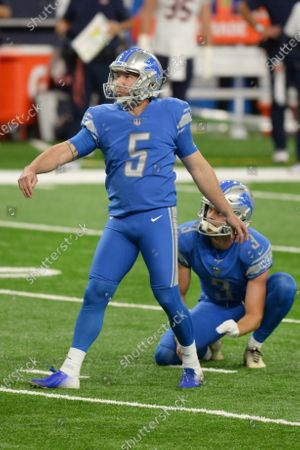 Detroit Lions kicker Matt Prater, left, and punter Jack Fox watch as Prater's field goal attempt is good against the Chicago Bears in the first half of an NFL football game in Detroit