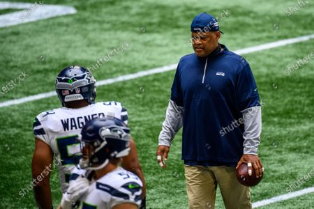 Stock Picture of Seattle Seahawks defensive coordinator Ken Norton, Jr. observes warm ups before an NFL football game against the Atlanta Falcons, in Atlanta. The Seattle Seahawks won 38-25