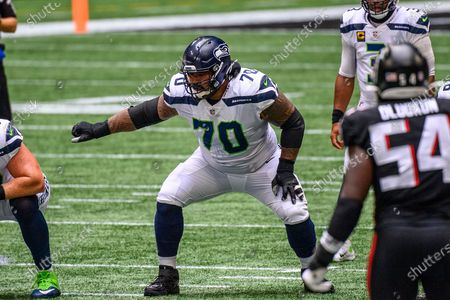 Seattle Seahawks offensive guard Mike Iupati (70) works against the Atlanta Falcons during the first half of an NFL football game, in Atlanta. The Seattle Seahawks won 38-25