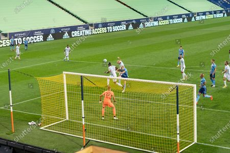 Kendall Waston (2) of FC Cincinnati defends during MLS regular season game against NYCFC at Red Bull Arena. Game was played without fans because of COVID-19 pandemic precaution. NYCFC won 2 - 1. All supporting staff and players on the bench were wearing facial masks and kept social distances. NYCFC won 2 - 1