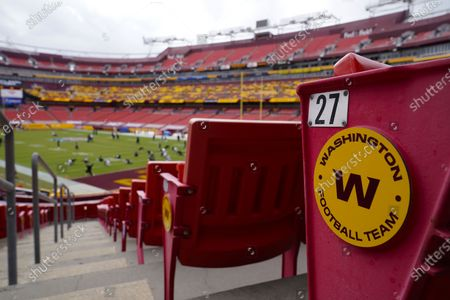 Seats at Fedex Field display the Washington Football Team logo on the seats during pregame warmups of an NFL football game between Washington Football Team and Philadelphia Eagles, in Landover, Md