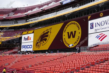 Stock Photo of Fedex Field screen displays the Washington Football Team logo during pregame warmups before the start of a NFL football game between Washington Football Team and Philadelphia Eagles, in Landover, Md