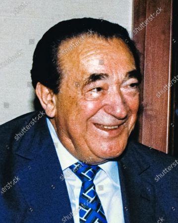 In this file photo from September 25, 1990, disgraced publisher Robert Maxwell meets South African Ambassador to the United States Piet G.J. Koornhof in Washington, DC on September 25, 1990. The New York Post is reporting today that Maxwell, through his daughter Ghislaine Maxwell, may have been the source the huge fortune amassed by alleged pedophile Jeffrey Epstein, who hanged himself in his Manhattan lockup last August.