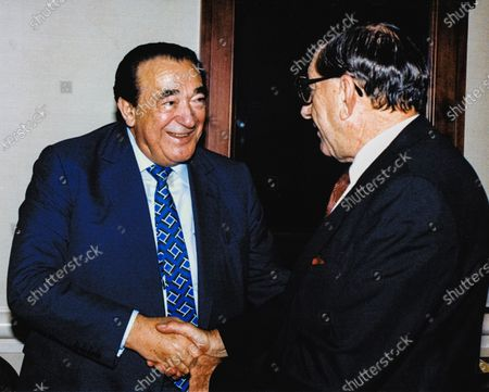 In this file photo from September 25, 1990, disgraced publisher Robert Maxwell, left, meets South African Ambassador to the United States Piet G.J. Koornhof in Washington, DC on September 25, 1990. The New York Post is reporting today that Maxwell, through his daughter Ghislaine Maxwell, may have been the source the huge fortune amassed by alleged pedophile Jeffrey Epstein, who hanged himself in his Manhattan lockup last August.