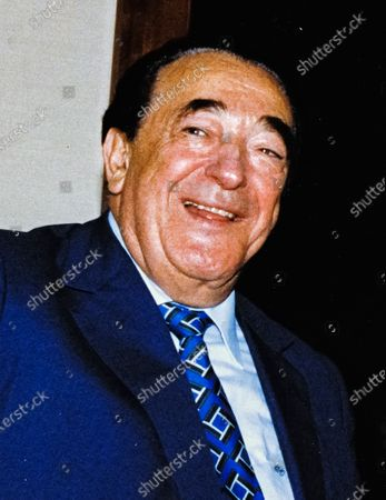 In this file photo from September 25, 1990, disgraced publisher Robert Maxwell, meets South African Ambassador to the United States Piet G.J. Koornhof in Washington, DC on September 25, 1990. The New York Post is reporting today that Maxwell, through his daughter Ghislaine Maxwell, may have been the source the huge fortune amassed by alleged pedophile Jeffrey Epstein, who hanged himself in his Manhattan lockup last August.