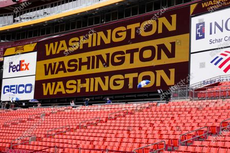 Fedex Field scoreboard displays the Washington Football Team name during warmups before the start of a NFL football game between Washington Football Team and Philadelphia Eagles, in Landover, Md