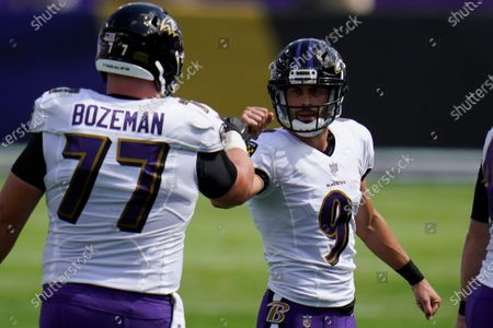 Baltimore Ravens offensive guard Bradley Bozeman (77) congratulates kicker Justin Tucker (9), after Tucker kicked a field goal, during the first half of an NFL football game against the Cleveland Browns, in Baltimore, MD