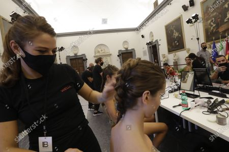 Models get their make-up done in the backstage, prior to the Italian fashion designer Laura Biagiotti's spring-summer 2021/22 collection show, in Rome's Piazza del Campidoglio city council square