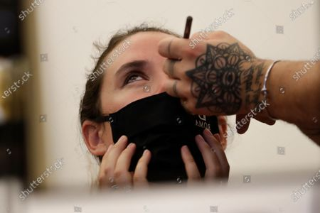 Model gets her make-up done in the backstage, prior to the Italian fashion designer Laura Biagiotti's spring-summer 2021/22 collection show, in Rome's Piazza del Campidoglio city council square