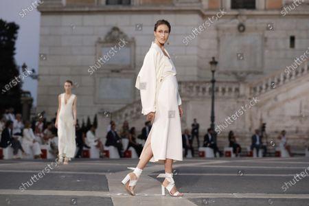 Model wears a creation part of Italian fashion designer Laura Biagiotti's spring-summer 2021/22 collection, unveiled in Rome's Piazza del Campidoglio city council square