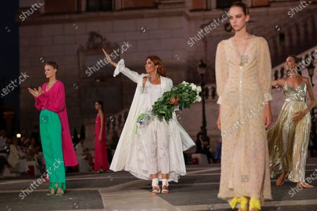Designer Lavinia Biagiotti acknowledges the applause of the audience after presenting Laura Biagiotti's spring-summer 2021/22 collection, unveiled in Rome's Piazza del Campidoglio city council square
