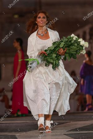 Stock Picture of Designer Lavinia Biagiotti acknowledges the applause of the audience after presenting Laura Biagiotti's spring-summer 2021/22 collection, unveiled in Rome's Piazza del Campidoglio city council square