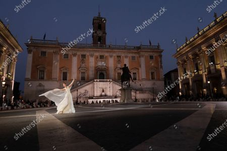 Stock Image of Model wears a creation part of Italian fashion designer Laura Biagiotti's spring-summer 2021/22 collection, unveiled in Rome's Piazza del Campidoglio city council square