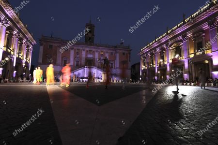 Models wear creations part of Italian fashion designer Laura Biagiotti's spring-summer 2021/22 collection, unveiled in Rome's Piazza del Campidoglio city council square