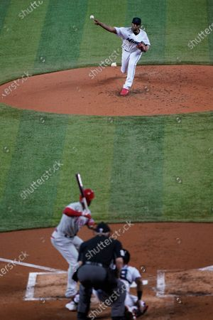 Miami Marlins' Sixto Sanchez, top, pitches to Philadelphia Phillies' Andrew McCutchen during the third inning of the first game of a baseball doubleheader, in Miami