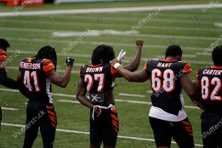 """Stock Picture of Cincinnati Bengals' Tony Brown (27) and Bobby Hart stand as """"Lift Every Voice and Sing"""" is played before an NFL football game between the Cincinnati Bengals and the Los Angeles Chargers, in Cincinnati"""