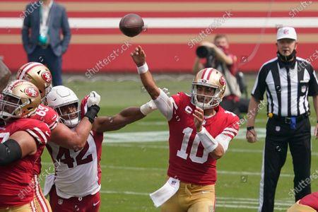San Francisco 49ers quarterback Jimmy Garoppolo (10) passes as Arizona Cardinals outside linebacker Devon Kennard (42) applies pressure during the first half of an NFL football game in Santa Clara, Calif