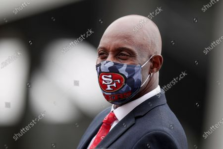 Stock Image of Former San Francisco 49ers wide receiver Jerry Rice looks onto the field before an NFL football game against the Arizona Cardinals, in Santa Clara, Calif