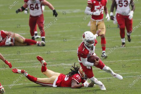 Arizona Cardinals quarterback Kyler Murray (1) runs past San Francisco 49ers cornerback Richard Sherman (25) to score a touchdown during the second half of an NFL football game in Santa Clara, Calif