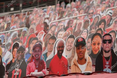 Cutouts of E-40, bottom left, Jerry Rice, bottom center, and Nate Diaz, bottom right, are seated at Levi's Stadium before an NFL football game between the San Francisco 49ers and the Arizona Cardinals in Santa Clara, Calif