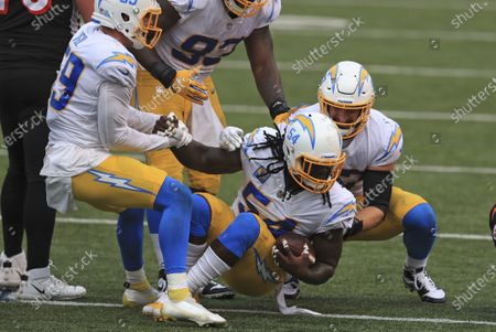 Los Angeles Chargers defensive end Melvin Ingram (54) celebrates after making an interception during the second half of an NFL football game against the Cincinnati Bengals, in Cincinnati