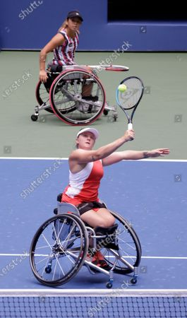 Stock Image of Jordanne Whiley of Great Britain (Bottom) hits a return next to her teammate Yui Kamiji of Japan during their match against Diede De Groot of the Netherlands and teammate Marjolein Buis of the Netherlands during the Women's Doubles Wheel Chair Final match on the fourteenth day of the US Open Tennis Championships the USTA National Tennis Center in Flushing Meadows, New York, USA, 13 September 2020. Due to the coronavirus pandemic, the US Open is being played without fans and runs from 31 August through 13 September.