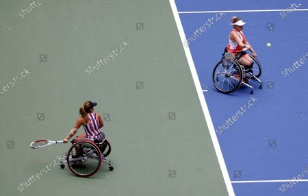 Jordanne Whiley of Great Britain (Right) hits a return next to her teammate Yui Kamiji of Japan (L) during their match against Diede De Groot of the Netherlands and teammate Marjolein Buis of the Netherlands during the Women's Doubles Wheel Chair Final match on the fourteenth day of the US Open Tennis Championships the USTA National Tennis Center in Flushing Meadows, New York, USA, 13 September 2020. Due to the coronavirus pandemic, the US Open is being played without fans and runs from 31 August through 13 September.