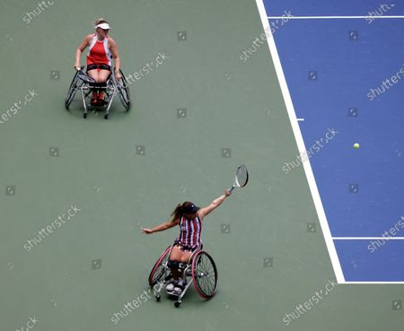 Stock Photo of Yui Kamiji of Japan (Bottom-Right) hits a return next to her teammate Jordanne Whiley of Great Britain (Top) during their match against Diede De Groot of the Netherlands and teammate Marjolein Buis of the Netherlands during the Women's Doubles Wheel Chair Final match on the fourteenth day of the US Open Tennis Championships the USTA National Tennis Center in Flushing Meadows, New York, USA, 13 September 2020. Due to the coronavirus pandemic, the US Open is being played without fans and runs from 31 August through 13 September.