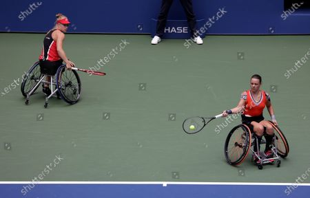 Marjolein Buis of the Netherlands (R) hits a return next to her teammate Diede De Groot of the Netherlands (L) during their match against Jordanne Whiley of Great Britain and her teammate Yui Kamiji of Japan during the Women's Doubles Wheel Chair Final match on the fourteenth day of the US Open Tennis Championships the USTA National Tennis Center in Flushing Meadows, New York, USA, 13 September 2020. Due to the coronavirus pandemic, the US Open is being played without fans and runs from 31 August through 13 September.